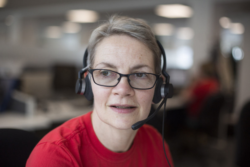 A Shelter helpline advisor wearing a headset