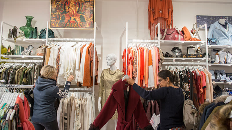 People browse the rails of Shelter's boutique shop