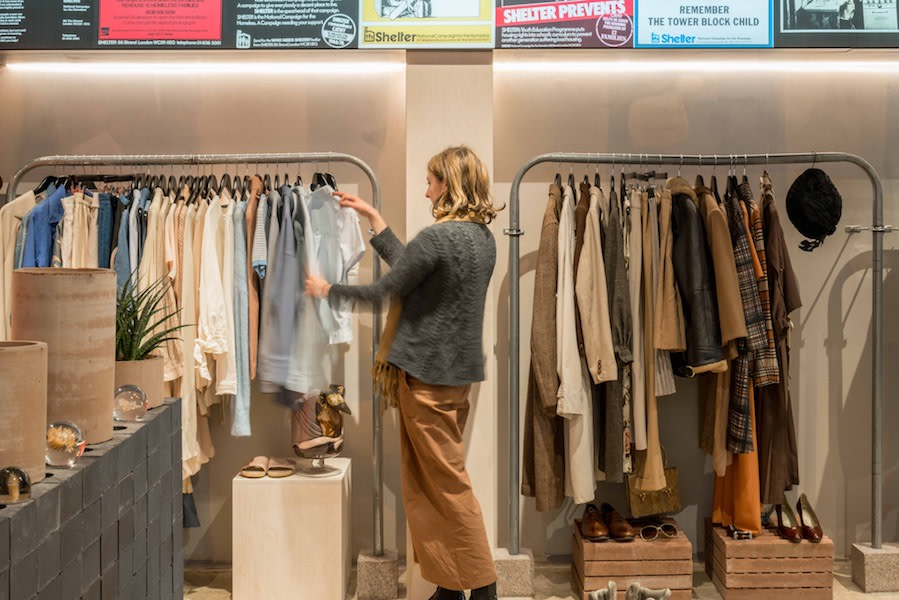 A sales assistant hangs clothes at our King's Cross Boutique