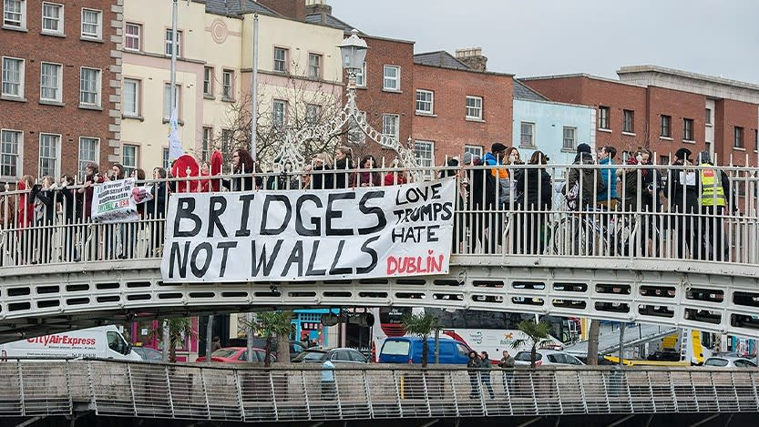 A banner drop in Dublin, Ireland. The banner slogan reads 'Bridges not walls'.