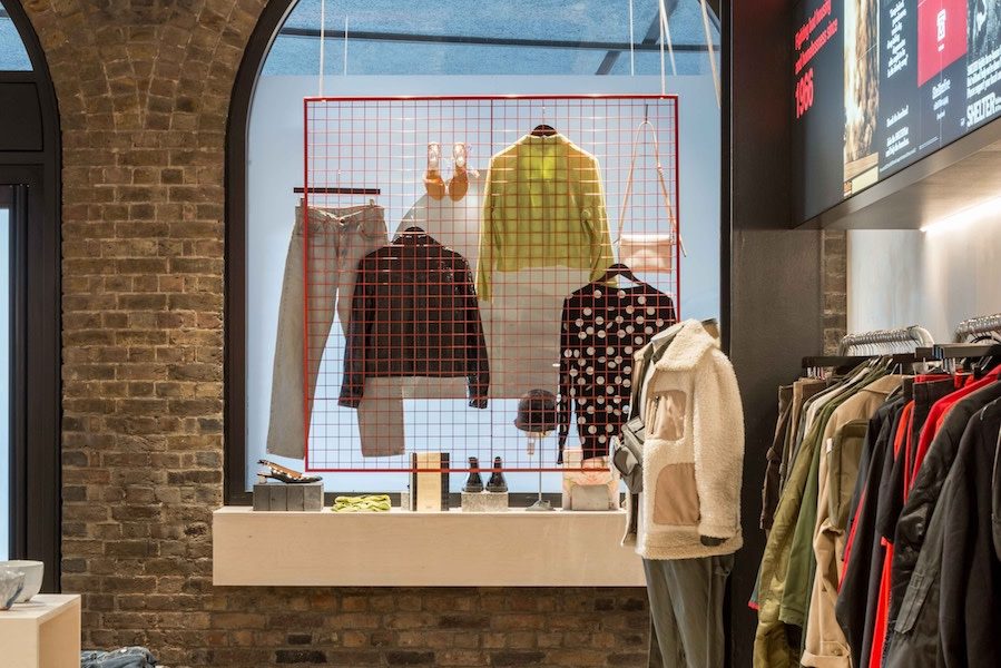 A display of jeans and denim jackets hang in the window at our King's Cross Boutique