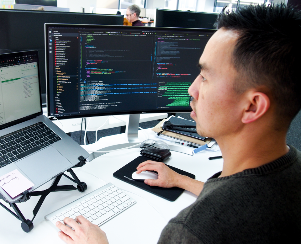 One of Boost's full-stack developers working on a software development project.
