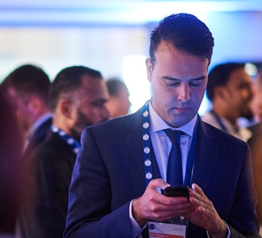 A delegate using the GS1 mobile app at the conference.