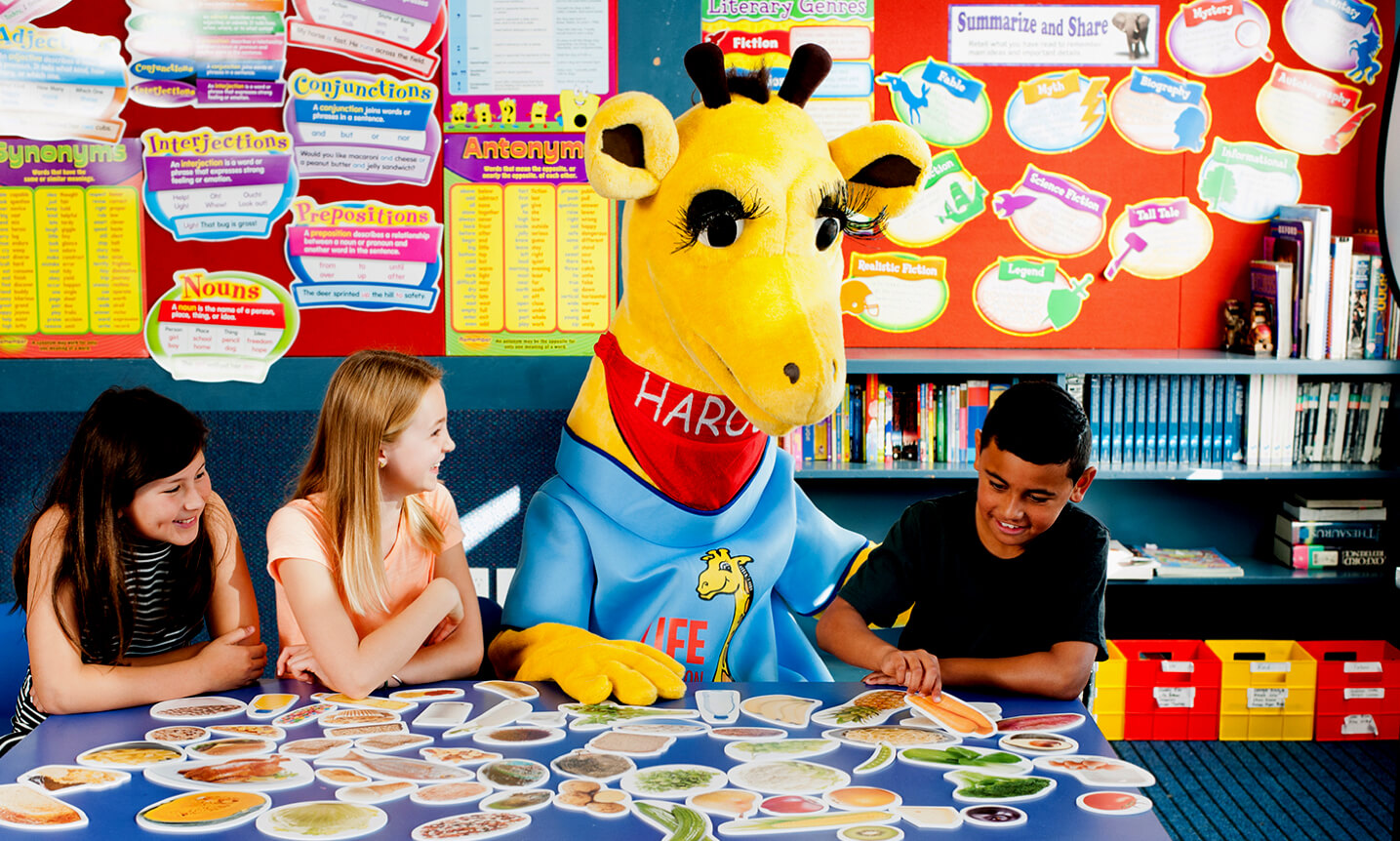 Healthy Harold helping kids in a classroom.
