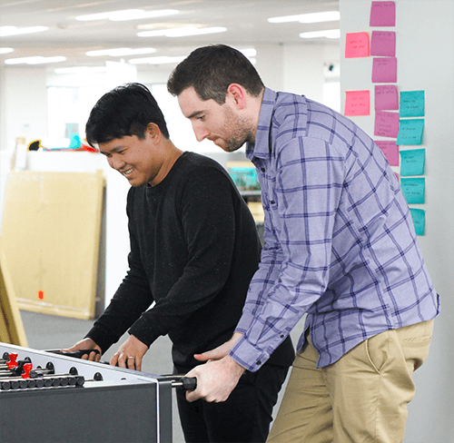 Playing foosball at Boost.