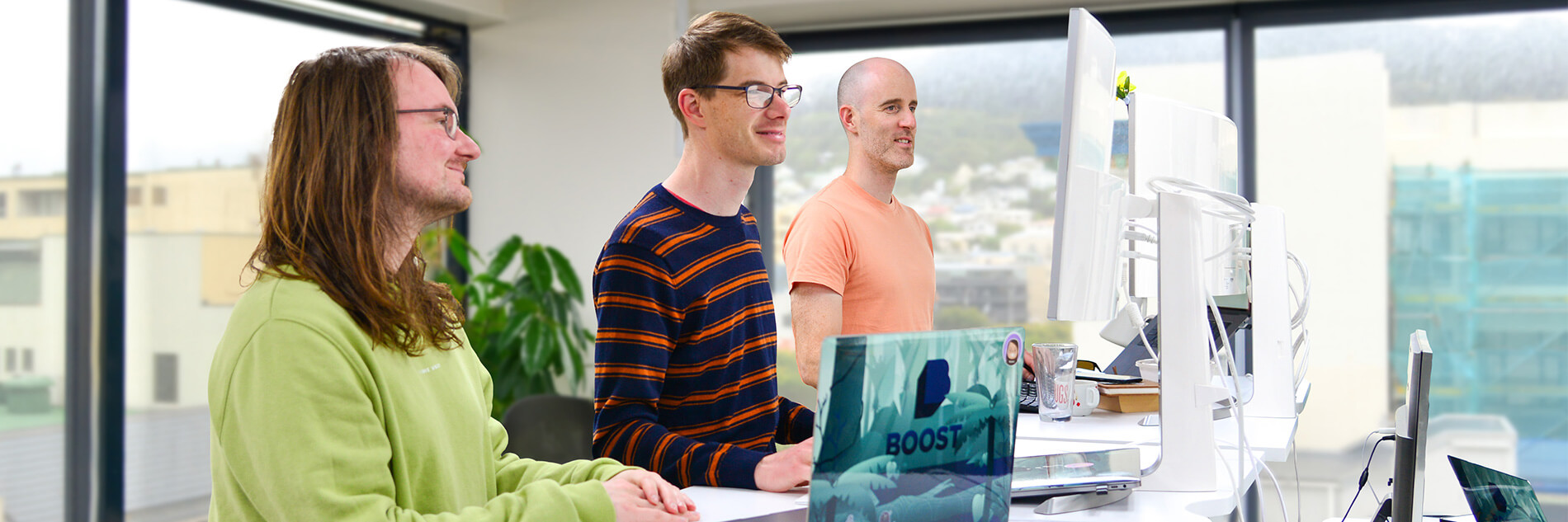 Three of the developers at Wellington mobile app development company Boost.