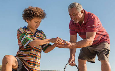 Father and son gather shellfish.