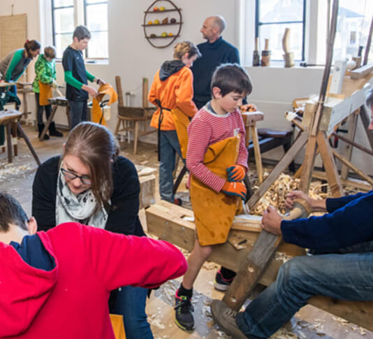 A children's spoon carving workshop underway at the Rekindle workshop, at Te Matatiki Toi Ora Arts Centre, Christchurch – Rekindle is a recipient of a 2019 Arts Grant. Image: Johannes van Kan.