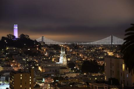 Night view of Coit Tower and Oakland Bay Bridge from Lombard Street