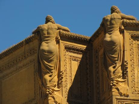 statues on top of san francisco palace of fine arts