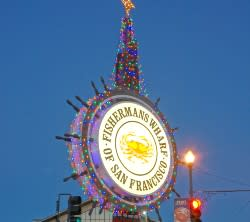 Fisherman's Wharf Crab Wheel sign with holiday lights