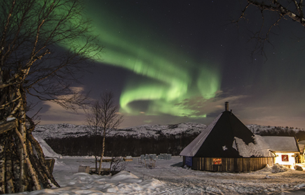 Aurora Borealis above snow hut
