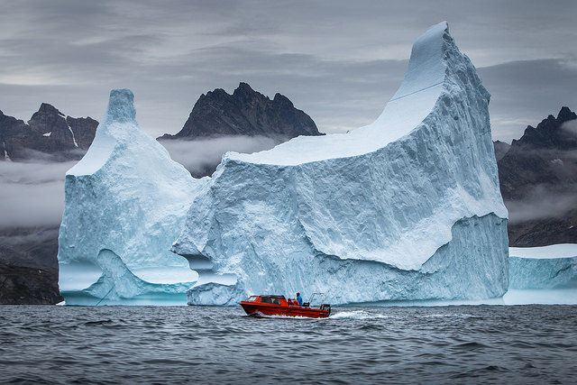 Small boat and big iceberg near Tasiilaq