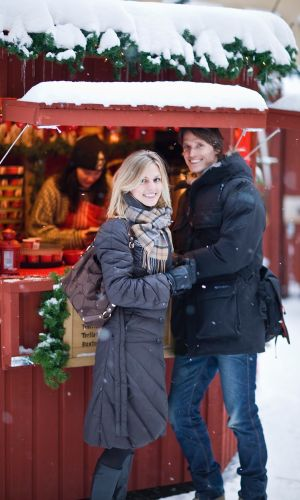 Couple at Christmas Market, Stockholm Old Town. Credit: Visit Stockholm, Henrik T