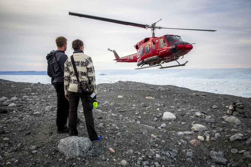 An Air Greenland Bell 212 helicopter approaching a landing site near the Ilulissat ice fjord in Greenland