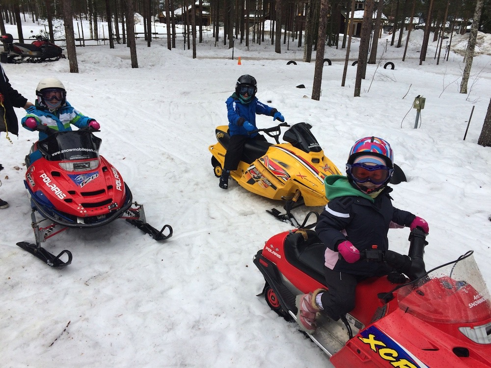 Snowmobiling with kids in Finland
