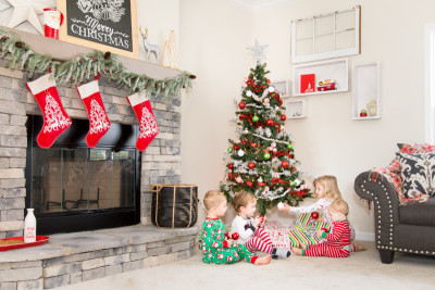 Children in Front of Christmas Tree