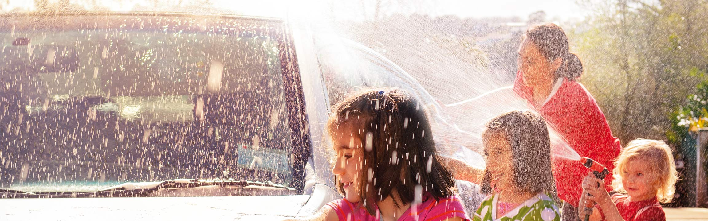 Children cleaning a car