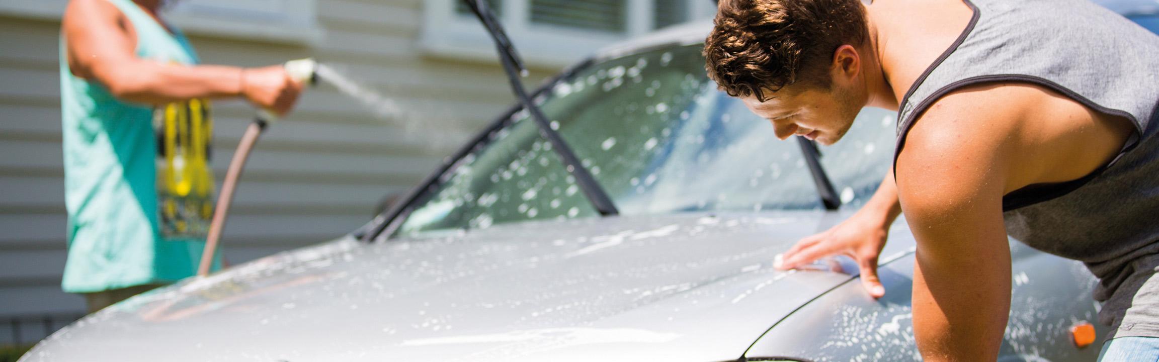Two men washing a car