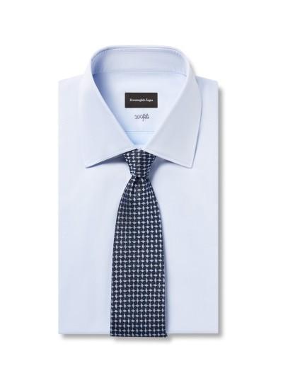 Light blue shirt dark blue patterned silk tie