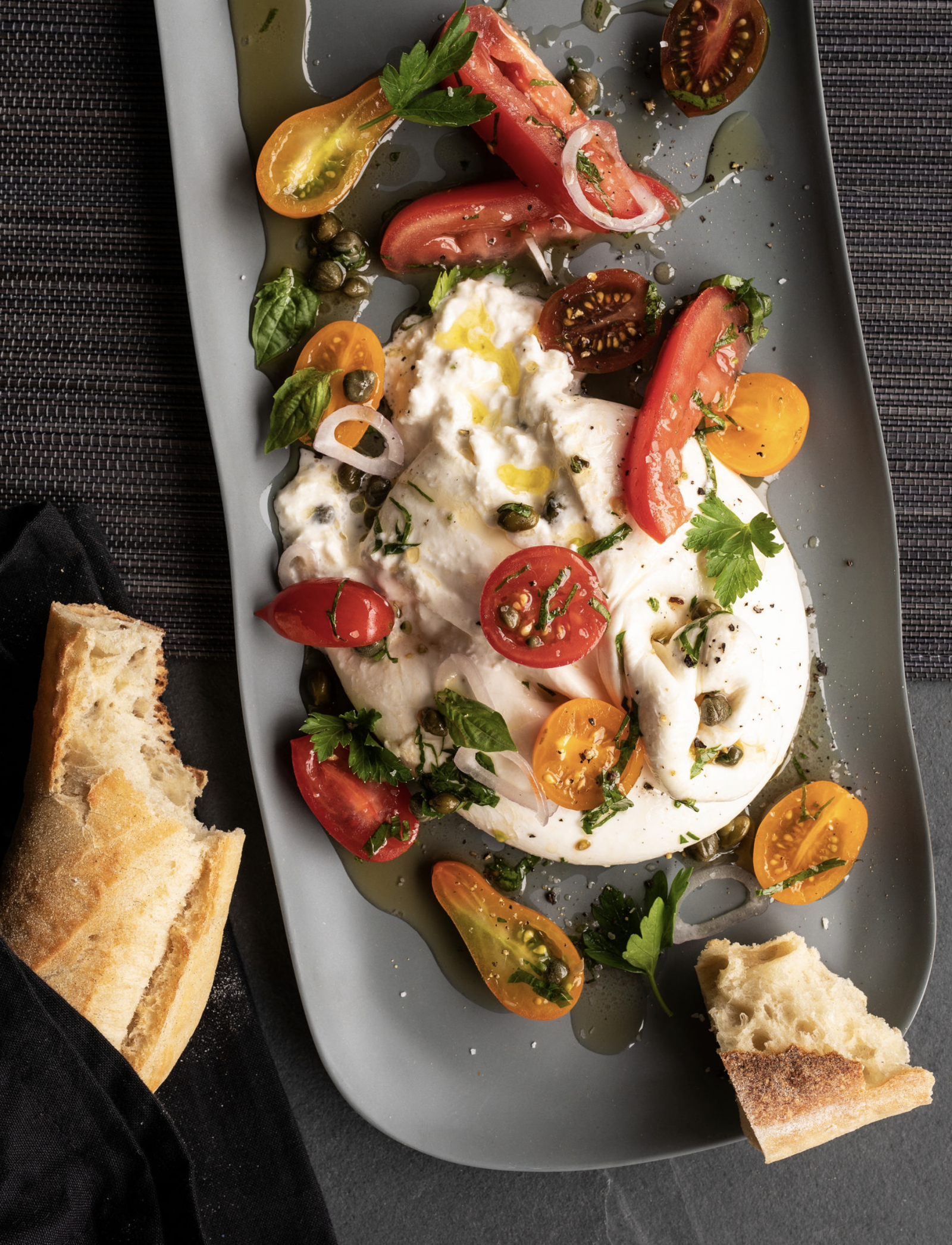 Runny burrata with Quebec cherry tomatoes and strawberries
