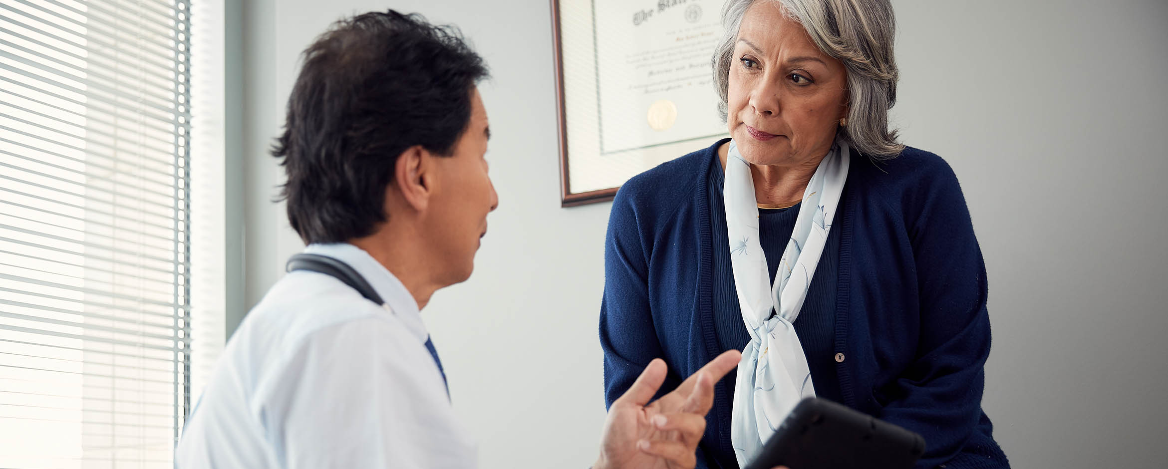 A patient discusses her options with her doctor.