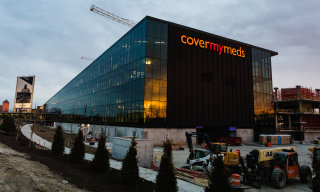 A photo of the exterior of campus with the CoverMyMeds sign visible.