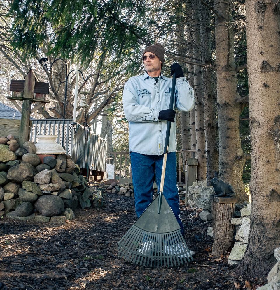 Michael holds a rake