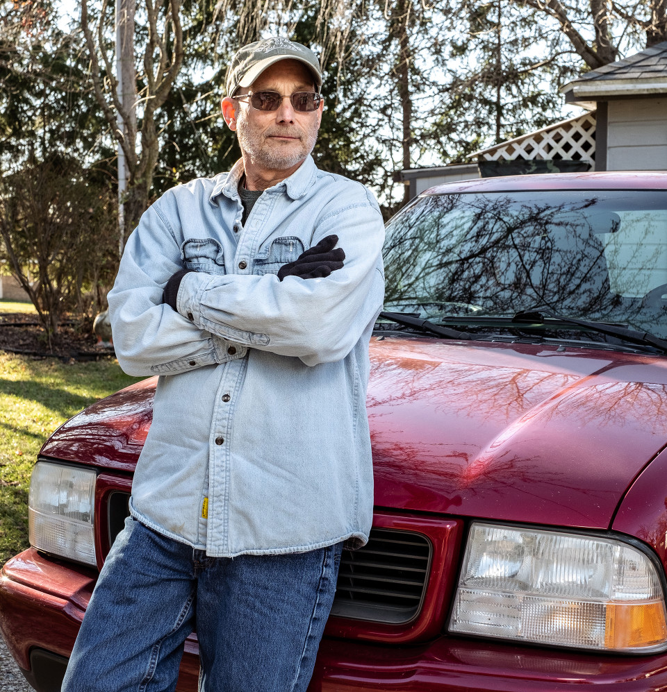 Michael stands with his truck