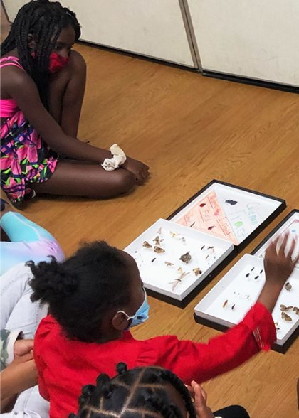 Students learn about STEM in a classroom.