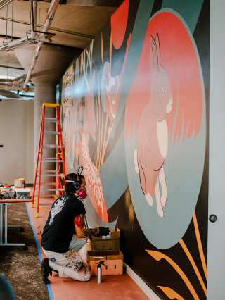 A mural being painted inside the CoverMyMeds campus.