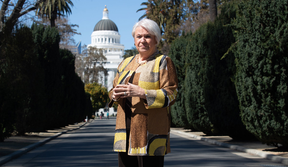 Joan stands in front of the California capitol building