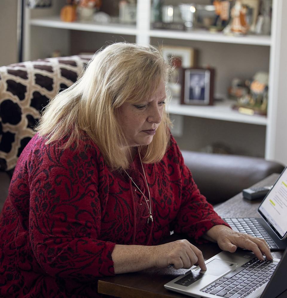 Julie at her computer