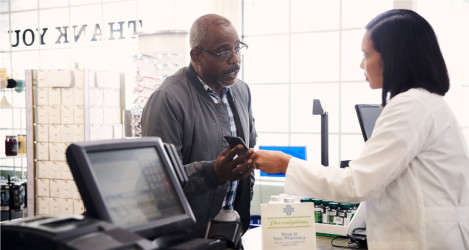 Patient shows pharmacist details on their smartphone.