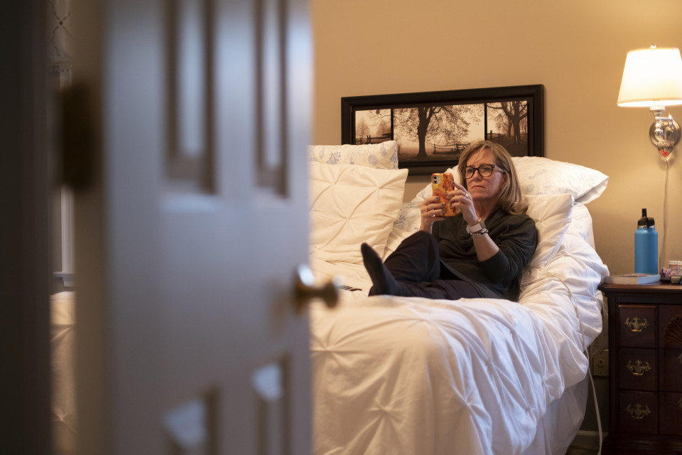 Kathy takes a call from bed