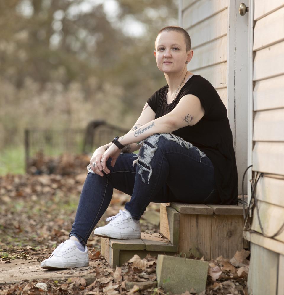 Ashley sits outside her rural Georgia home