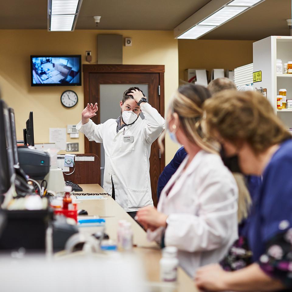 Pharmacist Greg managing staff