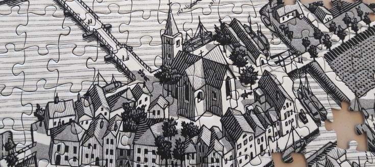 A jigsaw with a drawing of a town on