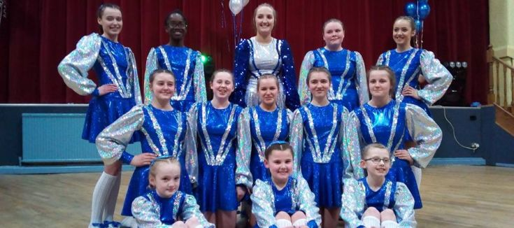 Dancers in blue clothing