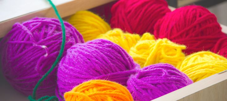 Different coloured wool in a drawer