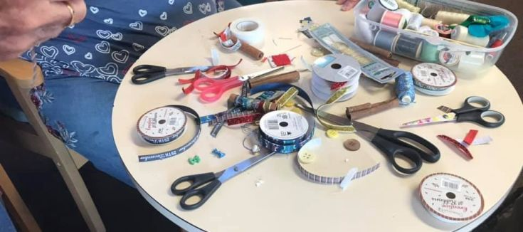 A table with craft materials on