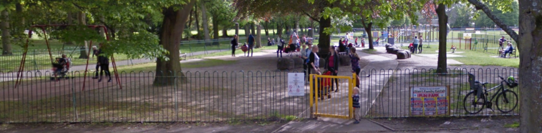 An entrance to a childrens play area in a park.