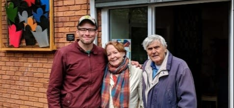Scott with 2 volunteers outside The Little Bookshop