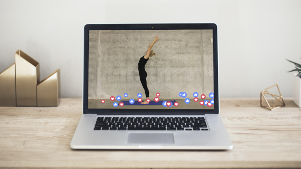 Photo of a laptop display showing an online yoga class