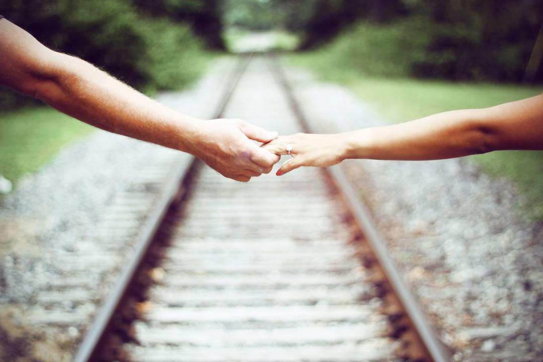 Traditional Wedding Vows for the Timeless Couple - couple on train rails