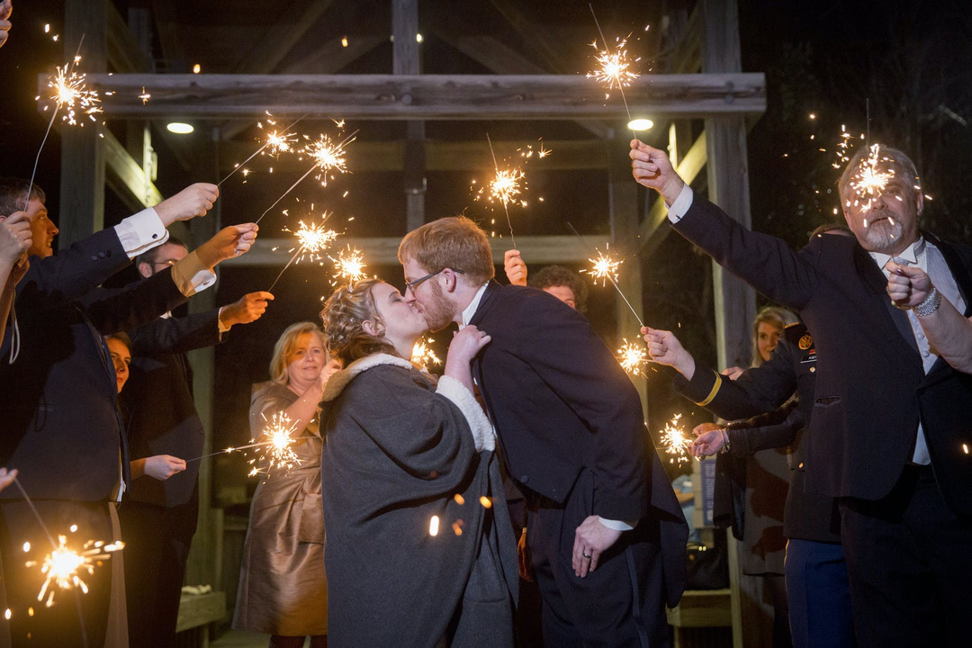 couple kissing with sparklers