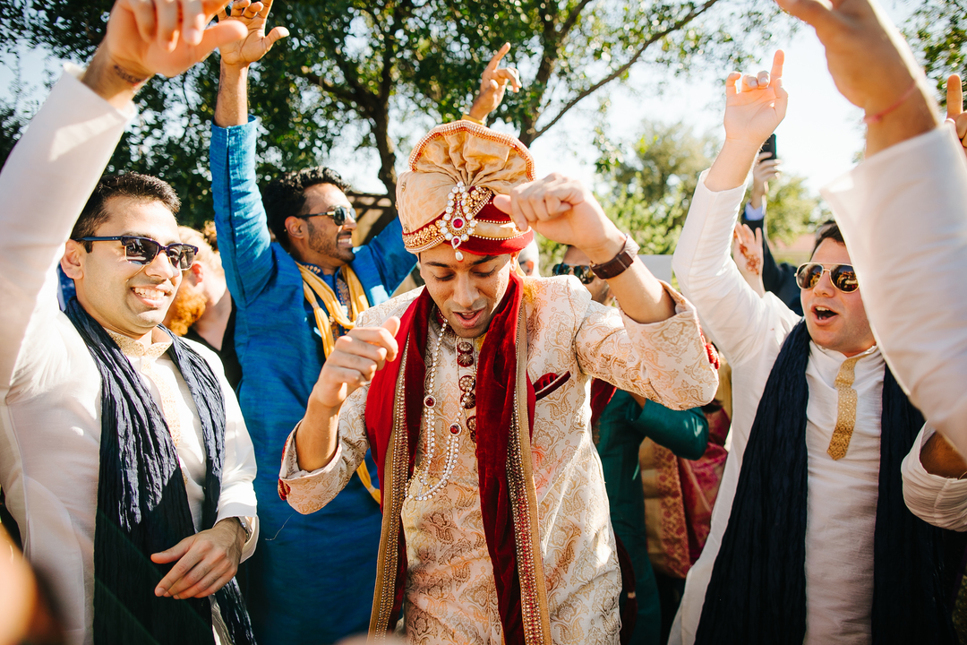 indian groom celebrates with wedding guests