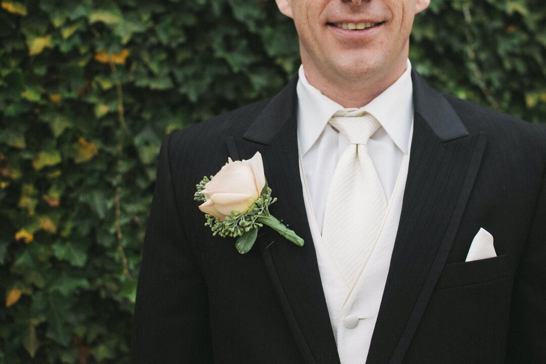 Groom in white tie attire