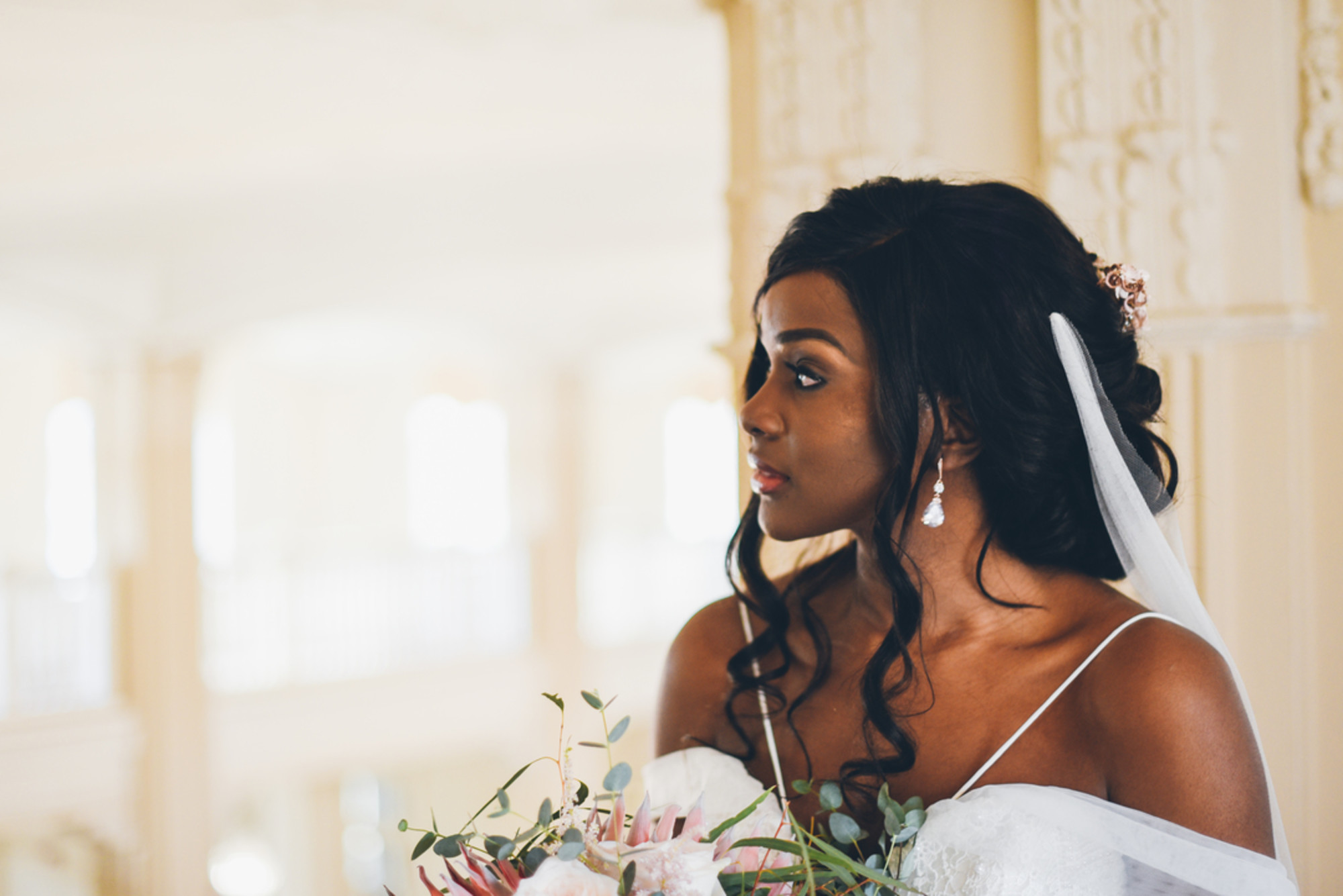 African-American bride side pose with beautiful hair curls