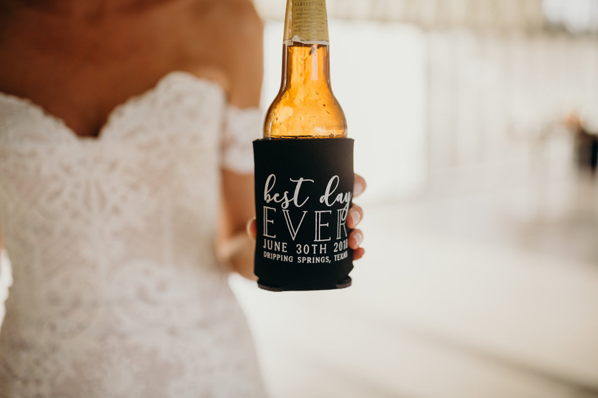 "bride holding a beer bottle in black ""best day ever"" wedding koozie"